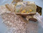 lace in tin box