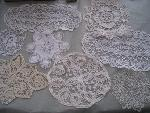 many lace doilies